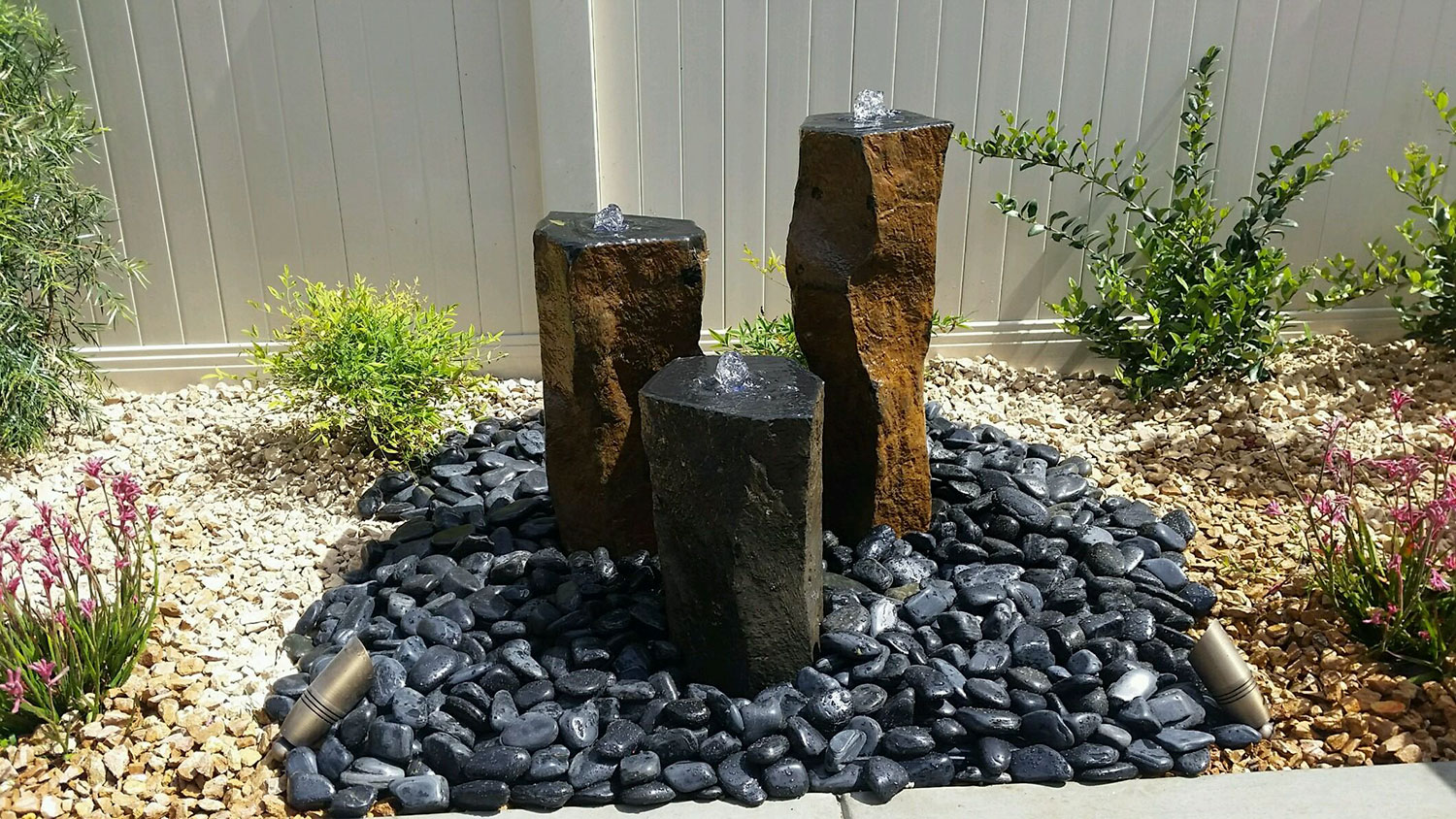 picture of Decorative High Polished Black Pebbles on Basalt Column