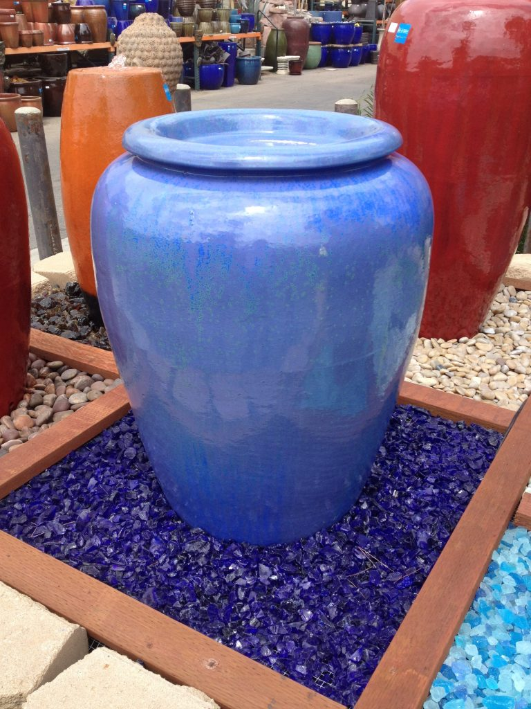 picture of ocean blue exotic landscape glass around a pot