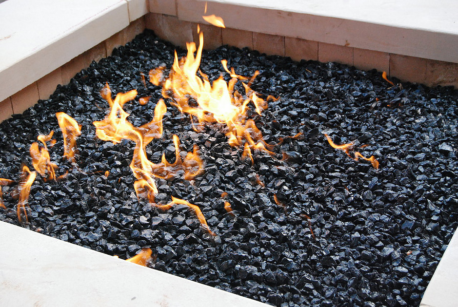 Fire glass is able to replace unsightly items in a fire pit or fireplace.  Items like ceramic logs or lava rocks. Traditional items that are put into  a ... - Fire Pit Glass - Everything You Need To Know