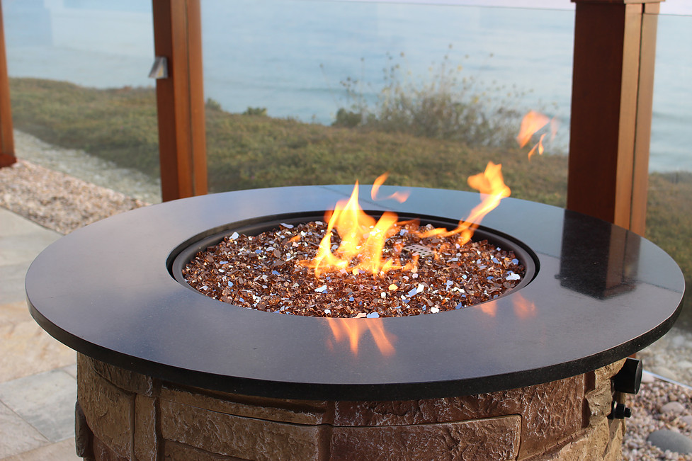 reflective fire glass burning with ocean background