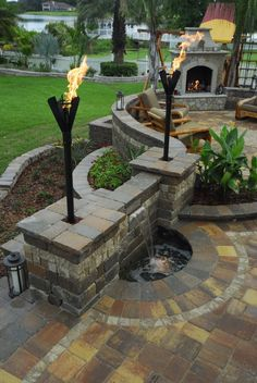 backyard patio with tiki torches